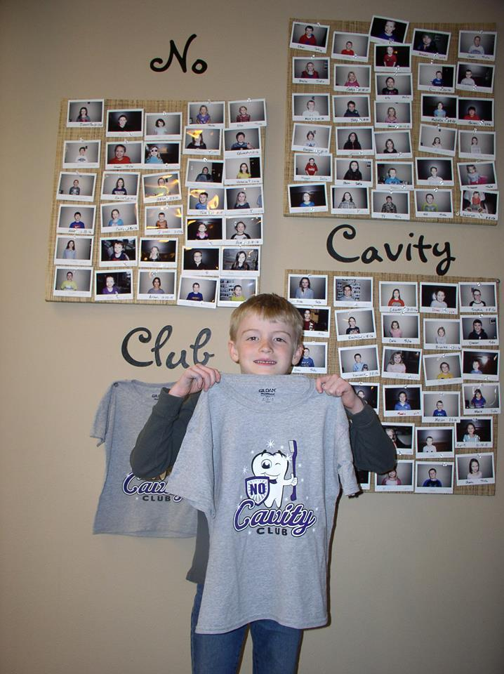 Boy holding No Cavity Club Shirt at our Children's Dentist in Mitchell, SD