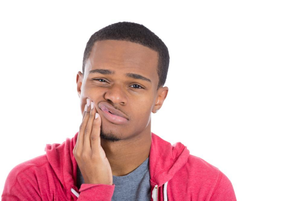 Man holding face in tooth pain | Dental Emergencies Mitchell SD