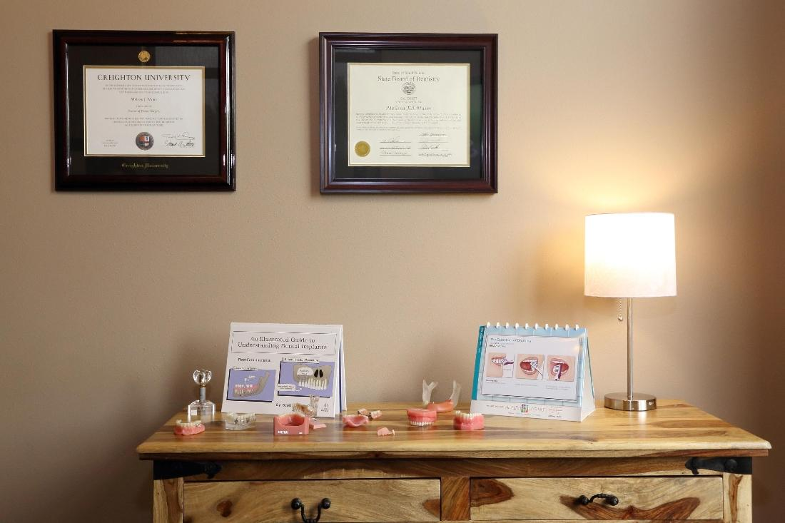 The dentist's diplomas at Dental Health Partners in Mitchell, SD